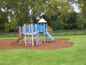 Children's climbing frame and slide.